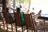 Lake Lodge, visitors sitting in rocking chairs on the porch