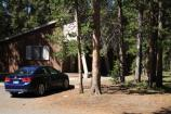Lake Lodge, car parked in front of cabin