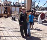 Park Guide Denise aboard Balclutha with a school group.