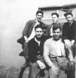VP-61 crew on Attu in 1944. Standing from left to right: Meir, Ordnance; Taylor, Radioman; Boleslaw Antonio Lada, 2nd Mechanic. Sitting from left to right: Kenneth Skinner, 1st Radioman; and Brasher, 1st Mechanic.