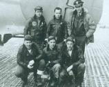 Six airmen pose in front of their bomber