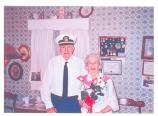 uniformed older man and woman
