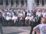 group of people in front of water fountain at memorial