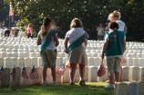 Girl Scouts place a flag on a Civil War grave in the National Cemetery at Andersonville National Historic Site