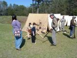 A Confederate Guard teaches a young visitor the finer points of 'Reverse Arms.'