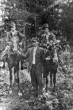 Marion Miller, Will Miller and Harve Winchester with their horses in the No Business Community.