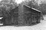 Built by John Blevins this log structure was the first house built on the Oscar Blevins farm. The building dates back to the mid-1800's.