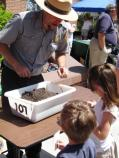 Planting flowers and trees with Fort Macon Ranger