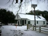 View of the Magnolia Plantation Store during the February snowfall.