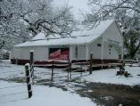 Oakland Plantation Store covered with snow.