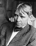 Carl Sandburg sitting for portrait. Place and date unknown.