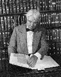Carl Sandburg perusing a collection of Lincoln papers; not an unusual activity for a man who spent 30 years studying Abraham Lincoln.