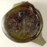 This wine bottle seal was found during archeological excavations. From Charles' parent's era, it bears the name