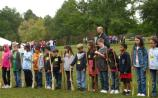 Students line up to learn the musket drill with wooden dummy guns.