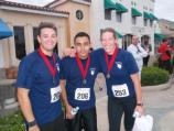 Everglades Firefighters Jacob Randall, Sergio Martinez and Jenn D'Emilio together after running a 3 mile race that raised money to help community organizations.