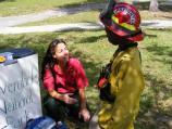 Firefighter teaching child about fire