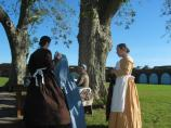 Women in period dress inside Fort Pulaski
