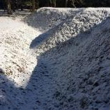 Snow highlighting earthwork details