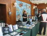 Alaska Geographic staffs a temporary information desk/bookstore while on board many cruise ships