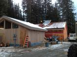 Cedar siding and roofing going on