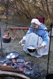 Cooking over an open fire is demontrated by volunteers at Guilford Courthouse National Military Park.