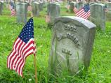 Flag placed on grave of soldier in observance of Memorial Day.