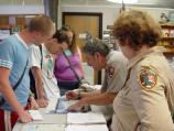 Barataria Preserve volunteer helps answer visitor questions at visitor center information desk