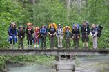 Group of backpackers standing in a line on a bridge on the Chilkoot Trail