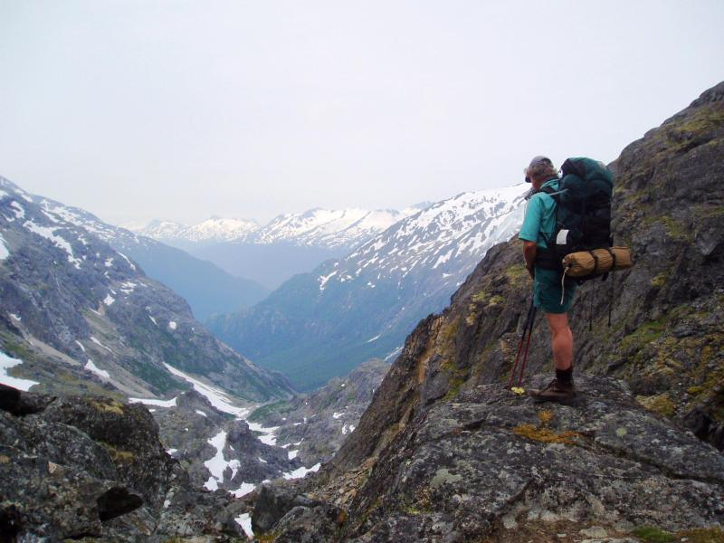 Stephen Dobert standing on rock near False Summit looking south toward Skagway, Alaska.