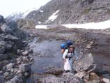 Nicole Bauberger hiking the Chilkoot Trail in a white dress