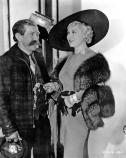 Posed black and white photo of Martin Itjen and Mae West