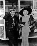 Martin Itjen and Mae West standing by the side of a streetcar
