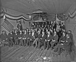 Black and White historic image of a group of uniformed men in a decorated building