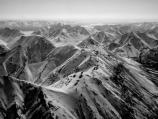 black and white image of snow-covered mountains