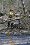 A sawyer clears fallen trees from Flint Ridge Road after the January 2009 ice storm.