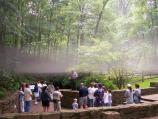 A layer of fog hangs over a tour group preparing to enter Mammoth Cave's Historic Entrance.