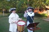 Reenactors entertain visitors playing Colonial music on the fife and drum.