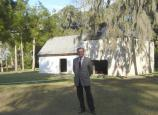 Jean-Marc Masseaut is standing outside of the Kingsley Plantation barn. This photograph was taken after his presentation.