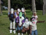Kids wearing masks they made at the Kids' Corner