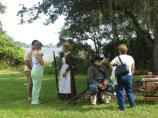Nurse and Confederate Private reenactors Glory and Lyn Wayman speak with visitors