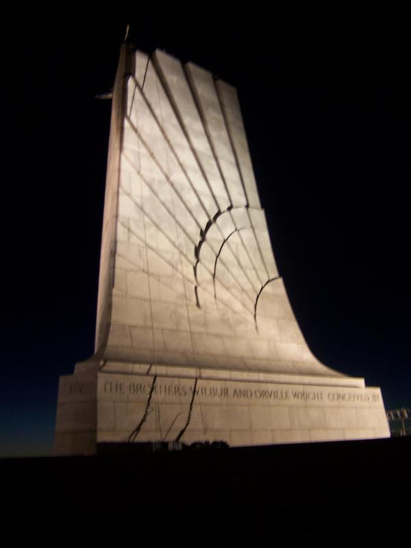 The Wright Brothers Monument at night after restoration