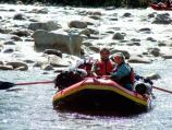 Rafters enjoy time after tense moments in rapids.