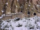 Snow covers Talus House, a reconstruction of an Ancestral Pueblo home that was built in 1920.