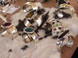 8 silver bracelets with gem stones on sale display