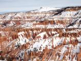 Winter snow on the red and orange spires of the Cedar Breaks Amphitheater