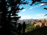 A mother and daughter enjoy the view of Cedar Breaks.
