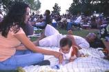 A family enjoys the outdoor musical concert.