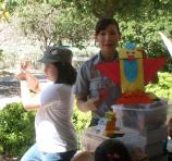Ranger Amber shows the puppet craft that Junior Rangers will make