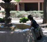 After a full day at the memorial, a Junior Ranger cools off at the Spanish Garden Fountain.