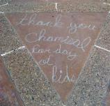 Chalk writing thanking Chamizal for a